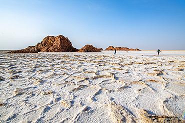 Tourist walk on salt flats in the Danakil Depression, Ethiopia