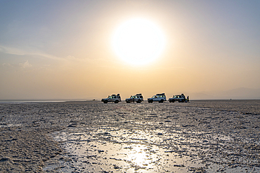 Land Cruisers and tourists in the middle of a salt flats in Danakil Depression, Ethiopia