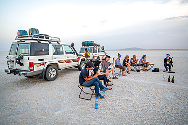 Tourists stop to drink and rest in the salt flats of the Danakli depression, Ethiopia.