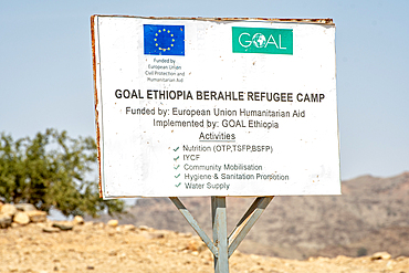A sign for the Goal Ethiopia Berahle Refugee Camp in Danakil Depression, Ethiopia