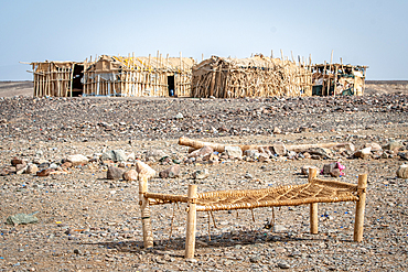 Shelters and cots at a salt miner campsite in the Danakil Depression, Ethiopia