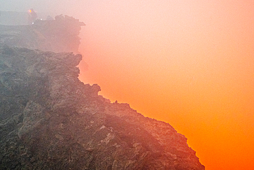 Apocalyptic look scenes as glowing red smoke pours out of Erta Ale Volcano, a continuously active basaltic shield volcano and lava lake in the Afar Region of Ethiopia