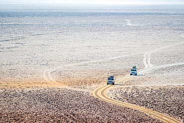 Vehicles and the salt flats in the Danakil Depression, Ethiopia