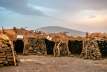 Primitively constructed huts near Erta Ale Volcano, a continuously active basaltic shield volcano and lava lake in the Afar Region of Ethiopia
