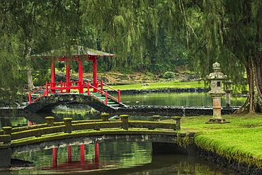 Fishpond, pagoda and bridges in the Japanese Garden of Liliuokalani Gardens in Hilo on the Big Island of Hawaii.