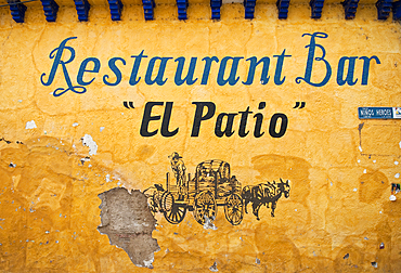 Sign on wall for El Patio restaurant and bar; Lake Chapala, Jalisco, Mexico.