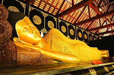 Reclining Buddha at Wat Chedi Luang Wora Wihan Buddhist temple in Chiang Mai, Thailand.