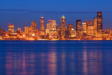 Downtown Seattle, Washington city skyline at dusk from Alki Beach.