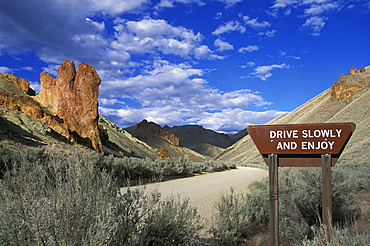 ?Drive Slowly and Enjoy? sign on dirt road in Leslie Gulch, southeast Oregon.