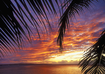 Sunset from the Pacific Islands Club resort with Tinian Island in the distance; Saipan, Northern Marianas Islands, Micronesia..