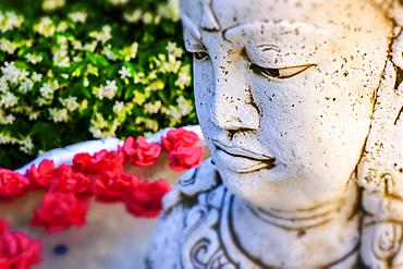 Brahma statue in a garden.