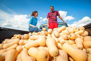 Students standing in a truck filled with gourds in Upper Marlboro, Maryland, USA