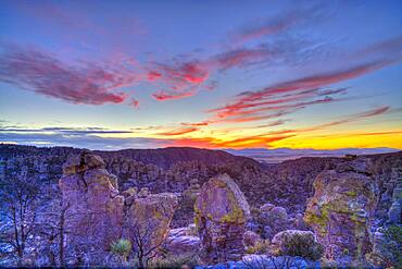 Sunset clouds and colours on December 3, 2013 from Massai Point, Chiricahua National Monument, Arizona. This is a 7-frame HDR High Dynamic Range stack to compress the high contrast from the bright sky and dark foreground into one image. Combined with Photomatix Pro. Taken with the Canon 5D MkIi and Canon 24mm lens at f/8. From images _MG_6996_6997_6998_6999_7000_7001_7002 taken at 2/3rd stop increments.