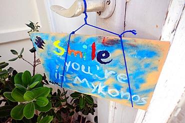 """Sign reads """"Smile you•re in Mykonos"""", Mykonos, Greece"""