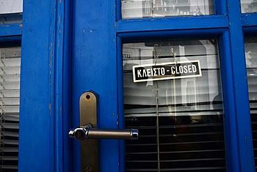Closed sign in door, Mykonos, Greece