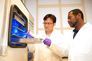 Scientists with freeze-dryer in food lab