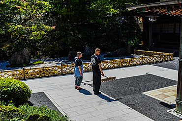 Monks working on Zen Garden at Yochi-in temple in Koyasan (Mount K?ya), a huge temple settlement in Wakayama Prefecture to the south of Osaka