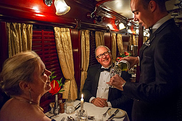 Passengers having dinner in the restaurant car of the The Rovos Rail luxury train travelling between Cape Town and Pretoria in South Africa Pride of Africa beautifully rebuilt Classic train that form part of the luxurious and privately owned Rovos Rail fleet