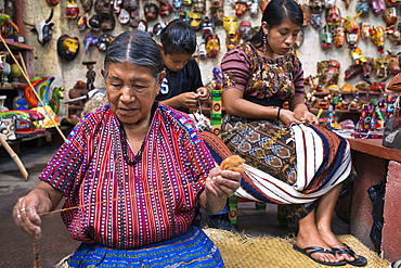 Nim Po't, souvenir shop in Antigua, Guatemala. Mayan women weave inside the store. Nimpot is a handicraft shop located in the heart of Antigua Guatemala, at our shop you will find the best hadicrafts of the country, we also sale high quality textiles and you can find a huge variety from every single area of Guatemala. Guipiles (blouse), cortes (skirt), masks, belts (fajas) and much more.