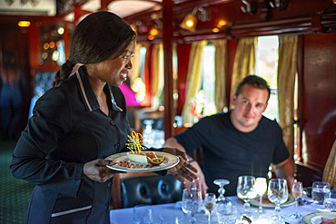Passengers having lunch in the restaurant car of the The Rovos Rail luxury train travelling between Cape Town and Pretoria in South Africa Pride of Africa beautifully rebuilt Classic train that form part of the luxurious and privately owned Rovos Rail fleet
