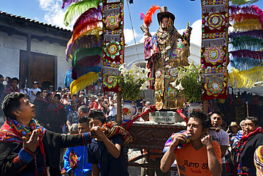 Chichicastenango, Quiche, Guatemala, Central America. Processions of Festival of Santo Thomas. On Easter Sunday The Comrades (Council Men) Carry The Andas (Floats) Of The Saints In Procession From The Santo Tomas