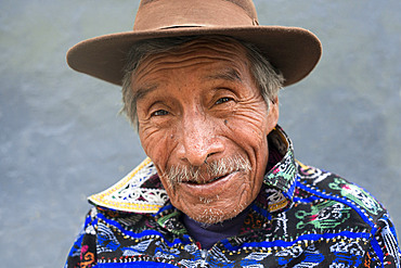 Portrait of a man in traditional dress remain in one of the streets of Chichicastenango, Guatemala.