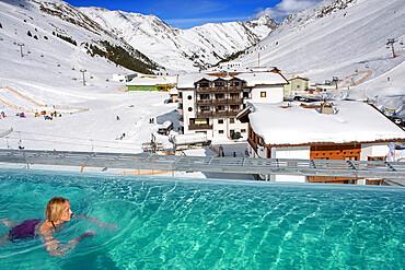 Kuhtai sky resort village and ski slopes near Innsbruck Tyrol Austria. Swimming pool of the Mooshaus Hotel.