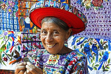 Concepcion Ramirez is the woman Tzutujil appears on coins of 25 cents of Guatemala. Woman in traditional dress as profiled on 25 cent coin Santiago Atitlan Guatemala Central America.