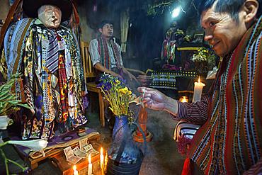 Shrine of El Maximon in Santiago De Atitlan, Guatemala. Maximon saint/devil is one of the strongest remnants of the Mayan faith