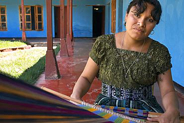 A mayan woman tz'utujile working in the textil in San Juan de la Laguna, Solol√°, Guatelama.