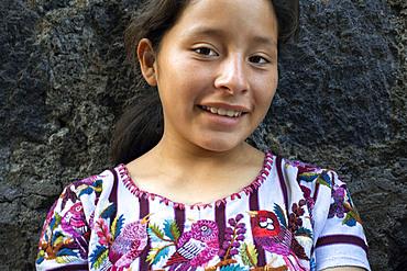 A gir Tzutujil dressed in traditional costume, San Juan de la Laguna, Solol√°, Guatemala.