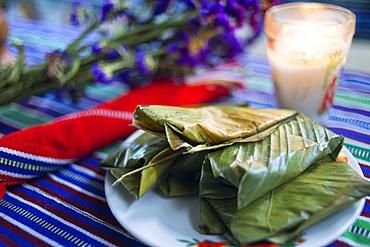 Local food, tamal served in Ixoq Ajkeem comunity, San Juan La Laguna, Solol√°, Guatemala. Santiago Atitlan, lake Atitlan, Guatemala.