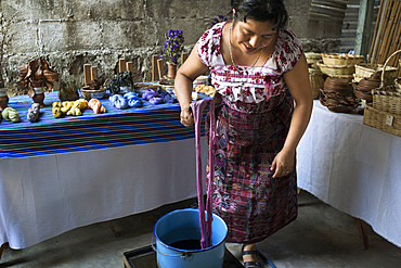 A Mayan woman use natural dyes to color fabrics. Ixoq Ajkeem comunity, San Juan La Laguna, Solol√°, Guatemala. Santiago Atitlan, lake Atitlan, Guatemala.