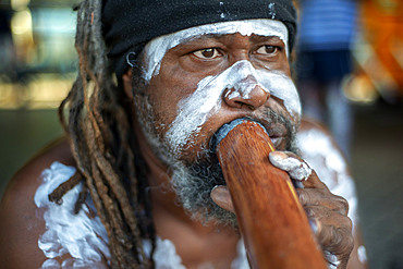 Australian Aboriginal dressed man selling music cd in The Rocks area at Circular Quay in Sydney New South Wales, Australia