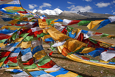 La Ken La pass or Laken pass at 5190 metres on the road to remote Nam Tso Lake Tibet. Namtso Lake Tibet China. Prayer flags next to the base of Mount Nyenchen Tanglha 7111 meters high, Tibet China. One of the holy mountains for Tibetans. The Nyenchen Tanglha is the highest peak of the Nyainqentanglha mountain. It is located near Lhasa, on the Qinghai-Tibet paved road. It is surrounded by grassy plains from Damshung to the south and to the picturesque sacred Nam Tso Lake (4,700 m, one of the largest lakes in the world) in the north.
