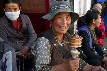 Tsepak Lhakhang Monastery. Lhasa Tibet China. Outside of Ramoche Temple. The women make a procession around the temple to ask the god of longevity Cherisi chepal to have a good delivery, or old people to pray to him.