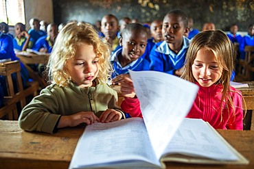 European blonde girls inside Inside primary and second school in a small village near Kitui city in the Kamba country in Kenya, Africa.