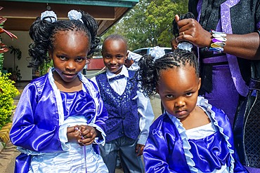 Rich family dressed to go to Christian sunday mass in a small village near Kitui in the Kamba country in Kenya, Africa.