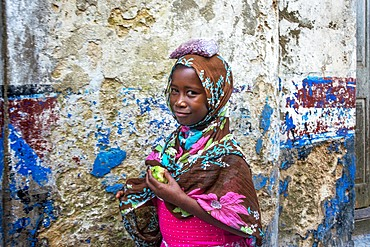Funy girl in the narrow strees of the city town of Lamu in Kenya