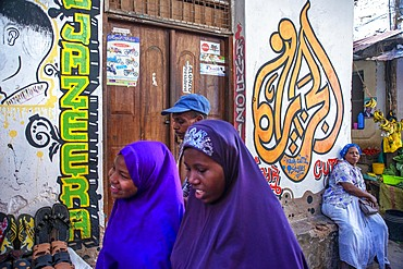Local people small shops and houses and narrow strees of the city town of Lamu in Kenya