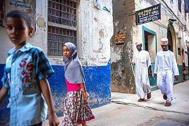 Local people in a narrow street of Lamu town in Lamu Island, Kenya.