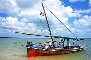 Tourists european family inside a dhow sailing boat in Manda island in Lamu archipelago in Kenya