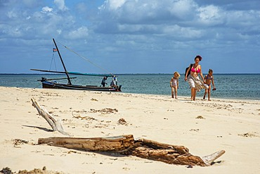 European Tourist family on the white beach in Manda island in Lamu archipelago in Kenya