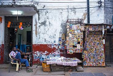 Magazine shop stall in a narrow street of Lamu town in Lamu Island, Kenya.