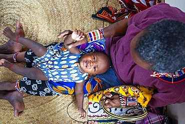 Taking care of the children. Afrikable spanish NGO in Lamu island Kenya. This association tries to empower women who have been victims of abuse. By making souvenirs that are later sold in the village store and the schooling of their children.