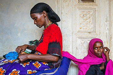 Sewing cloths to make souvenirs. Afrikable spanish NGO in Lamu island Kenya. This association tries to empower women who have been victims of abuse. By making souvenirs that are later sold in the village store and the schooling of their children.