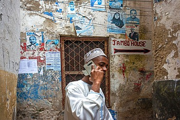 Local people in the narrow strees of the city town of Lamu island in Kenya