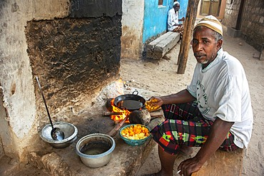Cooking in the street in the slum of Wiyoni department in the northern of the Lamu island in Kenya