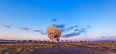 The Very Large Array (VLA) radio telescope in New Mexico, at sunset, March 17, 2013, with the Earth shadow rising at right and the pink Belt of Venus along the eastern horizon. This is a 2-section panorama, hand-held, with the 14mm lens and Canon 60Da camera.