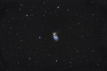 Messier 51, the Whirlpool Galaxy, the classic face-on spiral galaxy in Canes Venatici in the northern spring sky.